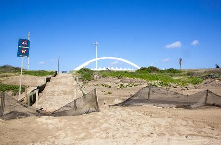stadium  durban: durbans moses mabhida stadium arch with dune rehabilitation in foreground Stock Photo