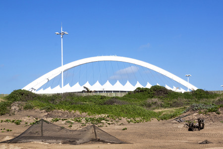 mabhida: Durban, South Africa - DECEMBER 4, 2014: View from beach of Moses Mabhida Stadium in Durban, South Africa Editorial