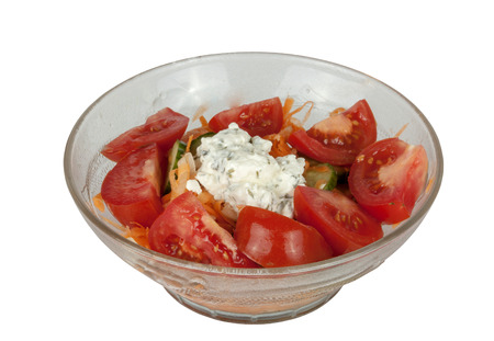 accompaniment: Isolated studio shot of bowl of tomato based salad accompaniment for indian curry Stock Photo
