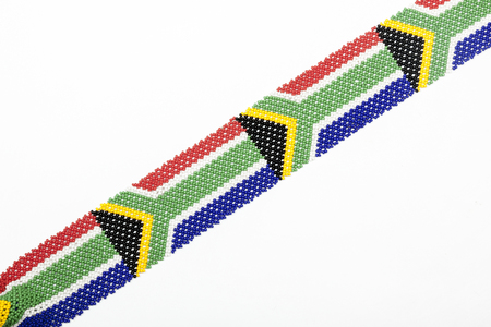 zulu: Close up Studio shot Zulu beads threaded in the colors of the South African flag on white