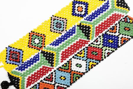 zulu: Close up studio shot of three zulu beaded bracelets in bright colors on white