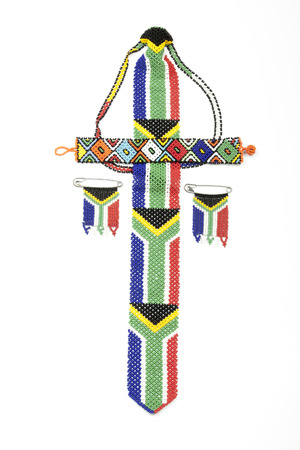 zulu: Studio shot above view of bright colored Zulu beads threaded in south african flag colors on white Stock Photo