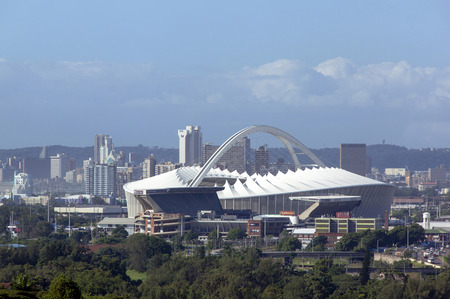 mabhida: DURBAN, SOUTH AFRICA - MARCH 23, 2016: Above view of Moses Mabhida stadium and city skyline in Durban South Africa