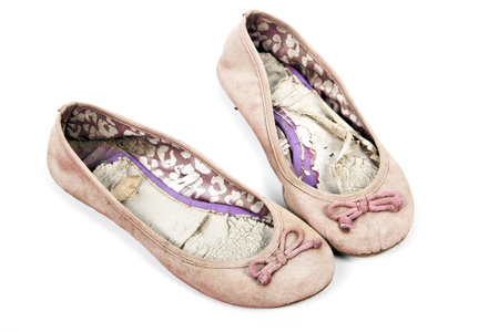 wornout: Pair of old well used  pink tattered female worn-out shoes on white Stock Photo