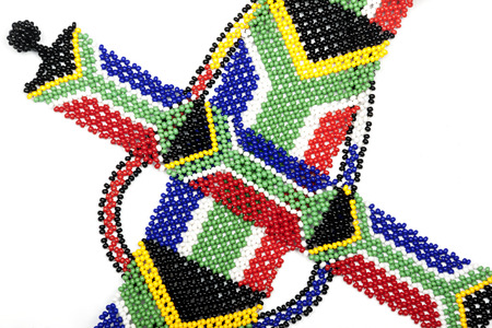 curios: Close up of ethnic Zulu bead bracelet in the colors of the south african flag Stock Photo