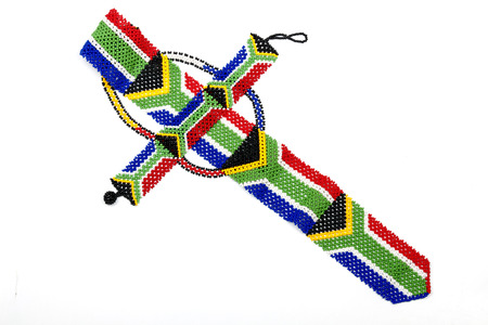 zulu: Colorful ethnic Zulu beads threaded into a necktie of the South Afican flag Stock Photo
