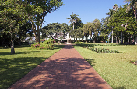 DURBAN, SOUTH AFRICA - APRIL 24, 2016: Four unknown people at paved pedestrian walkway at Botanical Gardens in Durban, South Africa Editorial