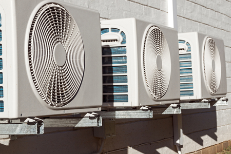 Newly installed airconditioning units mounted on brick exterior wall