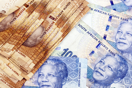rand: Closeup scattered collection of used South African twenty and  fifty Rand brown and blue bank notes