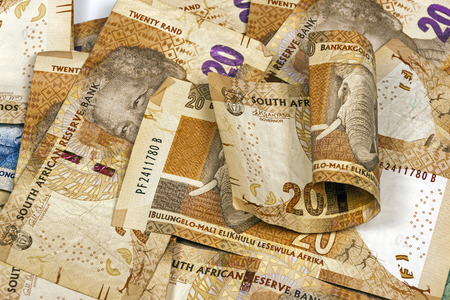 rand: Closeup scattered collection of used South African twenty Rand brown bank notes