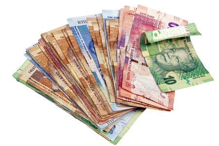 Above view of isolated spread South African Rand notes on white