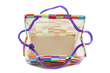 pack string: Above studio shot of open empty patterned colorful gift bag on white Stock Photo