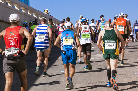 comrades: DURBAN, SOUTH AFRICA : MAY 29, 2016 : Many unknown spectators watch runners compete in the annual Comrades Marathon between Pietermaritzburg and Durban in South Africa Editorial