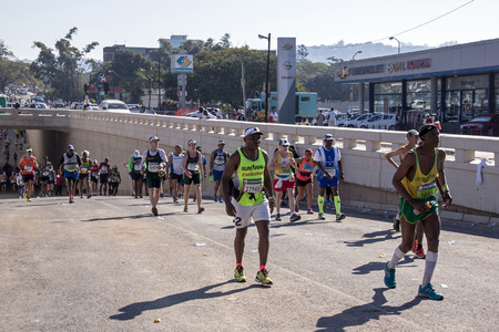 compete: DURBAN, SOUTH AFRICA : MAY 29, 2016 : Many unknown spectators watch runners compete in the annual Comrades Marathon between Pietermaritzburg and Durban in South Africa Editorial