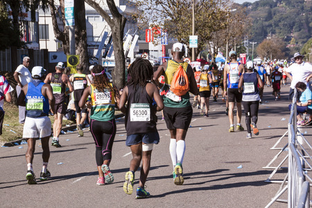 comrades: DURBAN, SOUTH AFRICA : MAY 29, 2016 : Many unknown spectators watch runners compete in the annual Comrades Marathon between Pietermaraizburg and Durban in South Africa