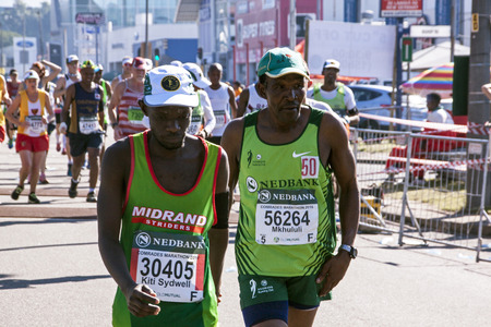 spectators: DURBAN, SOUTH AFRICA : MAY 29, 2016 : Many unknown spectators watch runners compete in the annual Comrades Marathon between Pietermaritzburg and Durban in South Africa Editorial