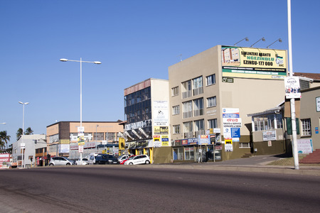 comercial: DURBAN, SOUTH AFRICA - JUNE 19, 2016:  Empty early morning Umgeni road heading past comercial buildings towards city centre in Durban, South Africa