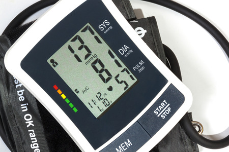 cuff: Close up view of blood pressure monitor cuff and pipe on over white