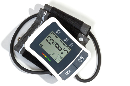 cuff: Above view of blood pressure monitor cuff and pipe on white background