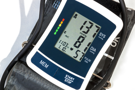 cuff: Close up right side view of blood pressure monitor cuff and pipe on over white Stock Photo