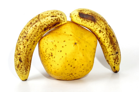 bannana: Studio shot of yellow paw paw under two ripe spekled bananas on white Stock Photo