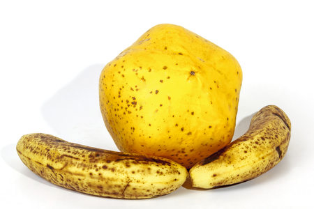 bannana: Studio shot Yellow paw paw with two ripe speckled bananas on white Stock Photo