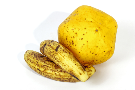 bannana: Studio shot of two speckled bananas alongside ripe yellow paw paw on white