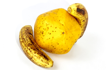 bannana: Studio shot of yellow paw paw with two ripe speckled bananas on white Stock Photo