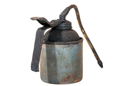 Studio shot of old grungy neglected rusty  blue oil can covered in layer of dirt and grime on white Stock Photo