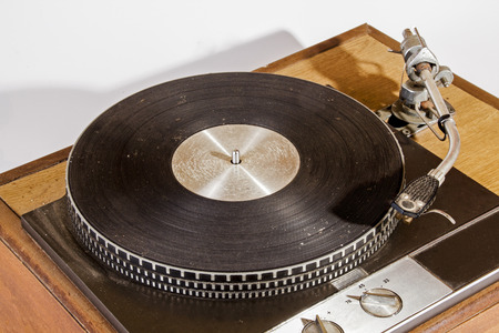 Overview  of wood mounted vintage neglected dusty grunge record playing turn table and switches