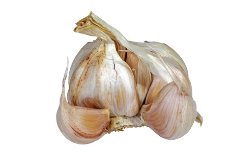 spiciness: Studio shot of isolated organic head and cloves of garlic on white background Stock Photo