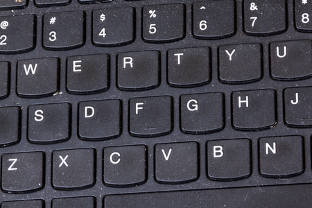 grimy: Close up of grimy black dirty dusty grungy neglected  laptop keyboard