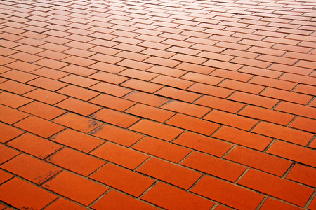 pavers: Close up of wet outdoor clay brick pavers forming a patterned pathway in wet rainy weather