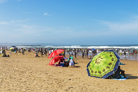 DURBAN, SOUTH AFRICA - DECEMBER 19, 2016: Many unknown people on afternoon visit on South Beach in Durban, South Africa Editorial