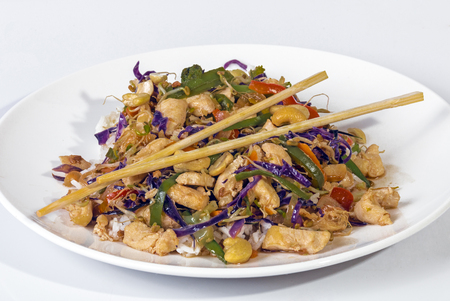 chop sticks: Close up studio shot of chicken mixed vegetable chop suey served on jasmine rice and chop sticks