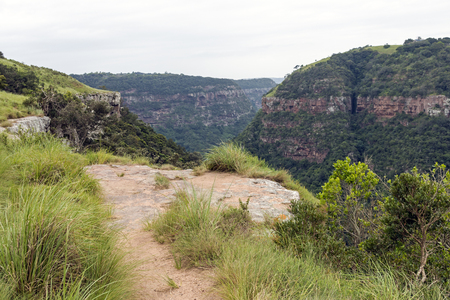 unprotected: Unprotected stone view site overlooking Kloof gorge and cliffs in Durban, South Africa Stock Photo
