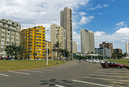 DURBAN, SOUTH AFRICA - DECEMBER 12, 2016: Quiet early morning parking lot against Golden mile city skyline in Durban, South SAfrica Editorial