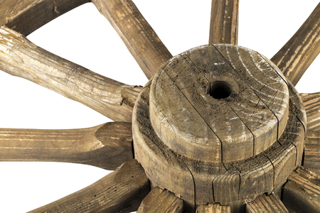 Close up  section of hub and spokes of vintage wooden weathered ornamental wagon wheel pattern and textures on white background