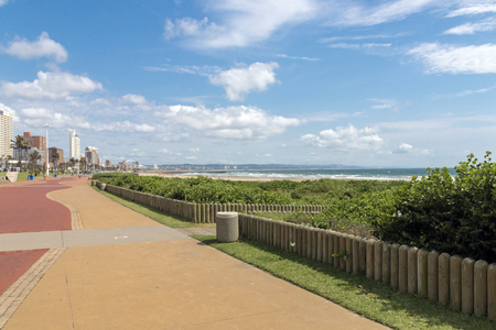 Empty early morning paved promenade against coastal city skyline in Durban. South Africa