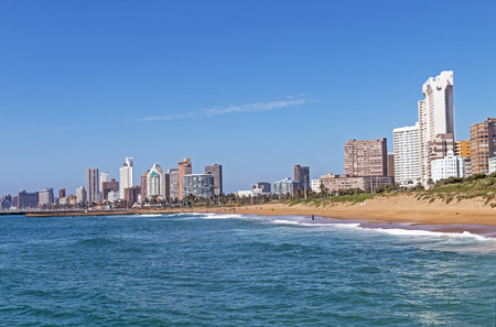 Coastal landscape with beach ocean blue sky and city skyline in Durban, South Africa Banco de Imagens