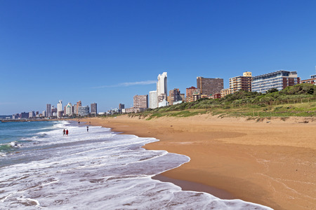 beachfront: Coastal landscape with beach ocean blue sky and city skyline in Durban, South Africa Stock Photo