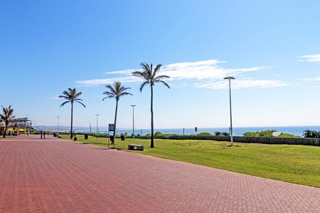empedrado: Quiet morning red paved promenade on Golden Mile Beachfront landscape in Durban South Africa Foto de archivo