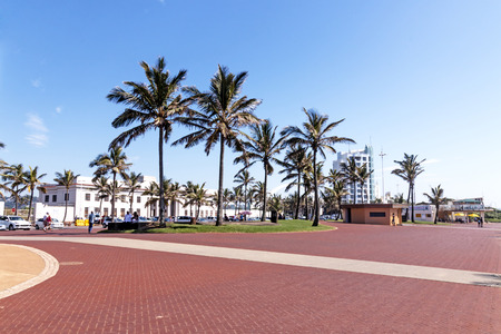 Quiet morning red paved promenade on Golden Mile Beachfront landscape in Durban South Africa Stock Photo
