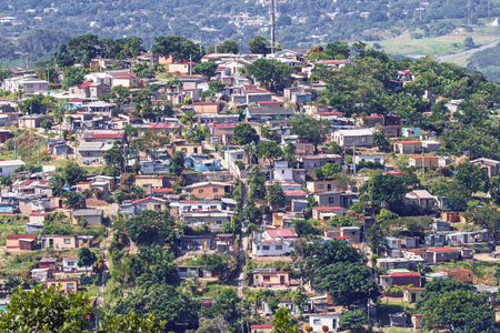 DURBAN, SOUTH AFRICA - APRIL 18, 2017: Above view of crowded low cost residential housing settlement landscape in Durban, South Africa Editorial