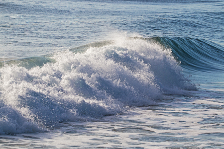Close-up blue water and wave breaking on beach in South Africa Stock Photo