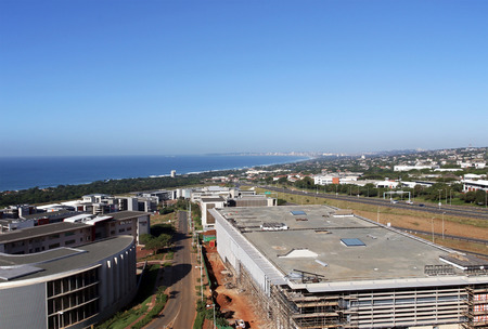 Above view of construction development and commercial and residential buildings urban coastal landscape against blue Durban city skyline in South Africa Editorial