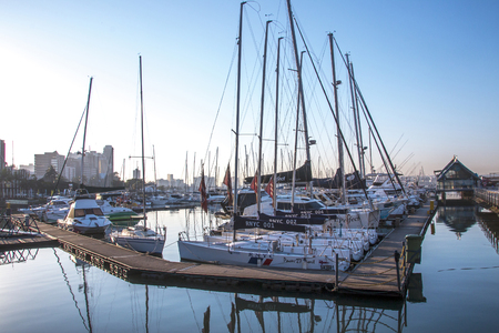 DURBAN, SOUTH AFRICA - JUNE 30, 2017: Early morning view of yachts moored at yacht mole in harbor against blue sky in Durban, South Africa Editorial