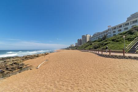 Empty Umhlanga Rocks beach and sea against blue sky coastal landscape in Durban, South Africa Banco de Imagens - 97232807