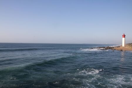 View of the umhlanga lighthouse and shoreline looking back from the pier
