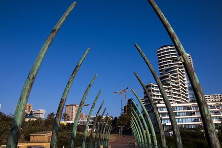 Whalebone structured pier at umhlanga facing the hotels and residential buildings on the shoreline